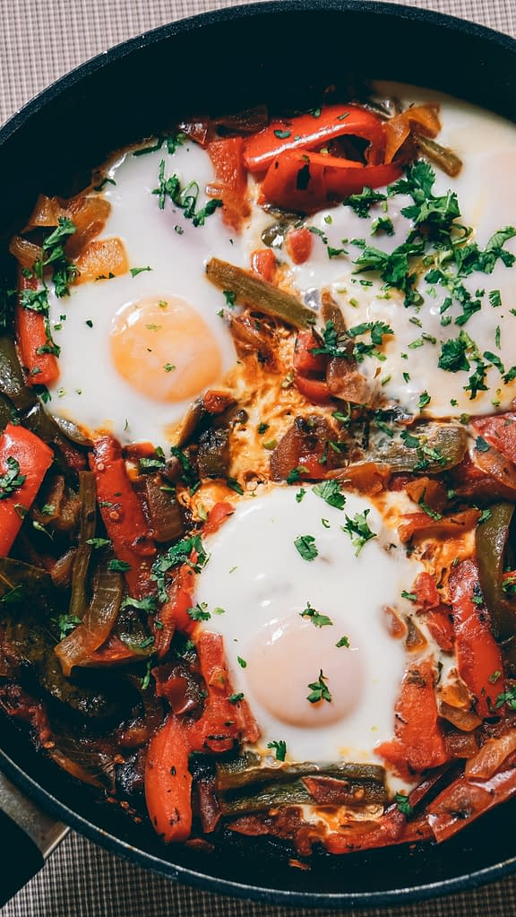 fried eggs with vegetables and parsley